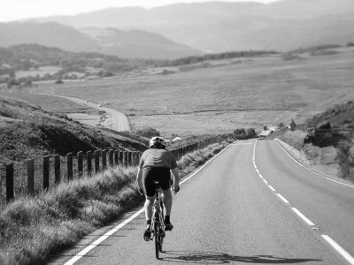 Cyclist descending in the welsh hills